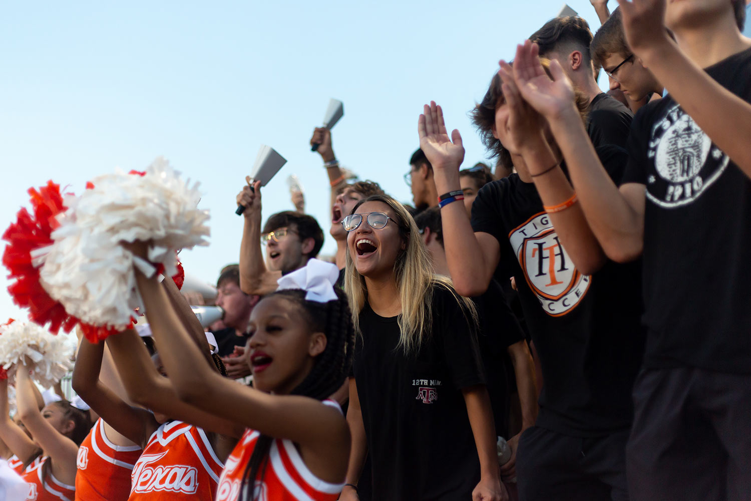 Senior Mya Bowers cheers for the Texas High Tigers as they play against Liberty Eylau. This was the first home game of the season for Texas High.