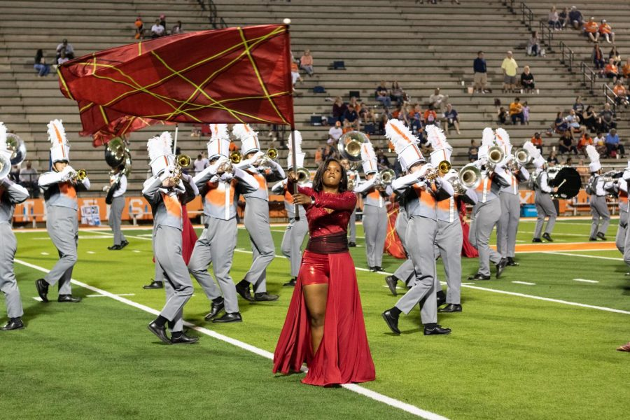 Junior+Armani+Griffie+dances+with+her+flag+during+halftime+at+Tiger+Stadium.+Color+Guard+performed+alongside+the+Marching+Band+at+football+games+during+the+2019+season.
