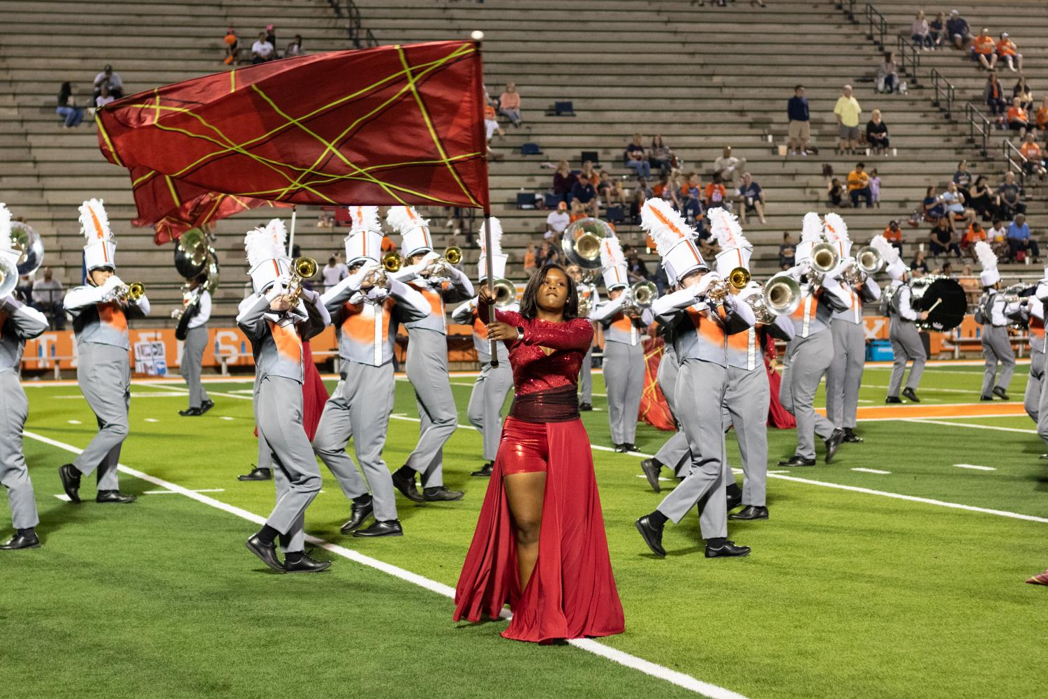 Junior Armani Griffie dances with her flag during halftime at Tiger Stadium. Color Guard performed alongside the Marching Band at football games during the 2019 season.