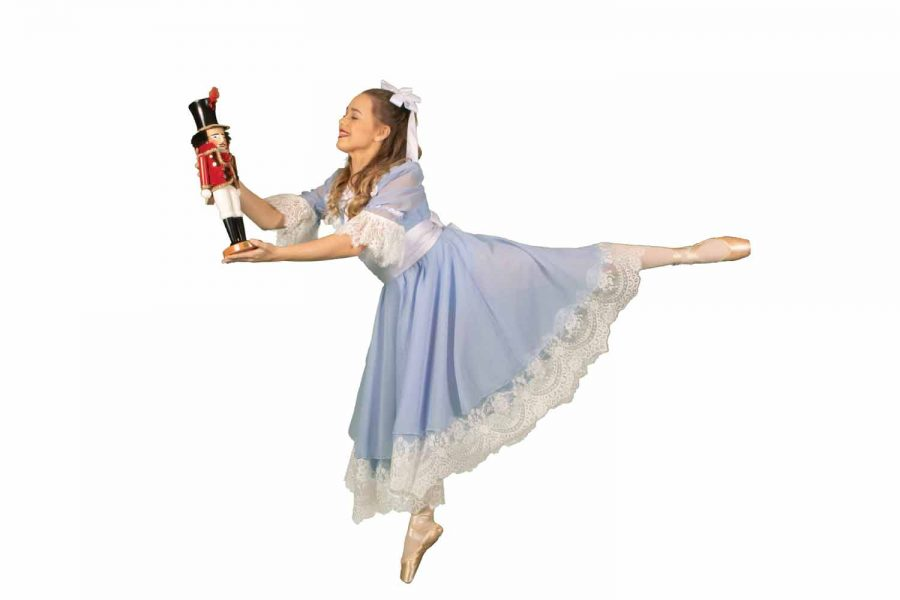 Helen Clark Hayes poses with her nutcracker doll. The nutcracker was a gift from her mother to celebrate her receiving the lead role of Clara.