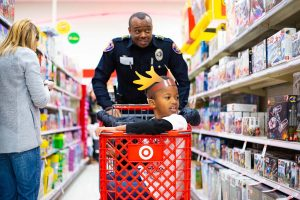 Police officer Alan Bailey shops with a child during the annual Shop with a Cop and Firefighter event Dec. 3 at Target.