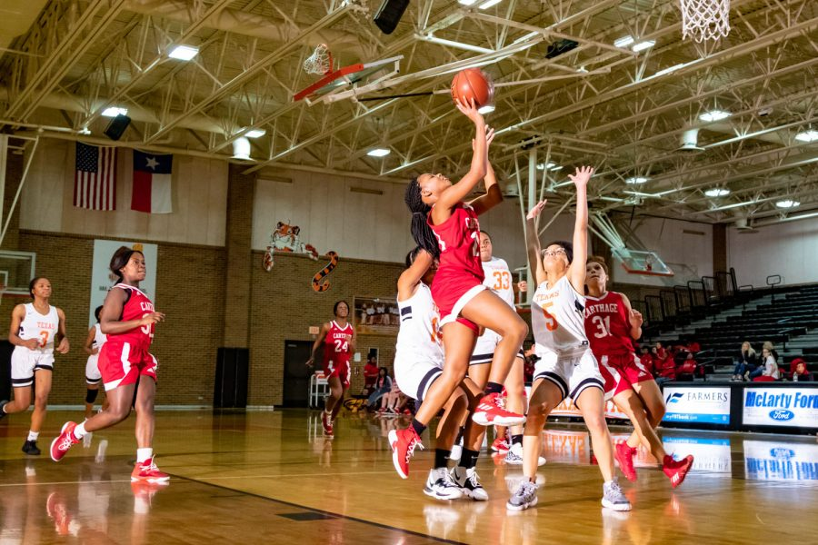Texas High School girl freshman basketball players attempt to defiant the opposing basket. The Texas High vs. Carthage freshman game took place on December 10th.
