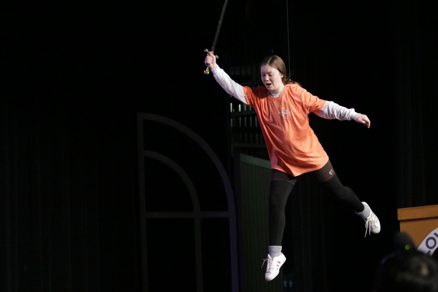 Junior Cate Rounds flies through the air as Peter Pan during dress rehearsal. This is the first time that Tiger Theater has had the opportunity to use a flying harness in a show.