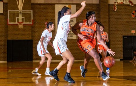 Texas High JV girls basketball player blocks opponent from continuing the play. Texas High battled Lancaster at the Texas High School Tiger Center.