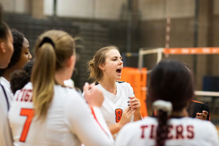 Senior Olivia Lower cheers on her team during a volleyball game. The varsity game against Pleasant Grove was held on Sept. 10, 2019.