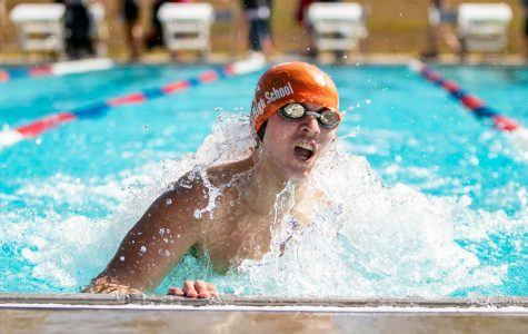 Senior Joshua Oldham turns during his 200 IM at the Tyler Quad Meet. This is the only outdoor meet of the season, and give swimmers an extra time to qualify for Frisco Tisca times.