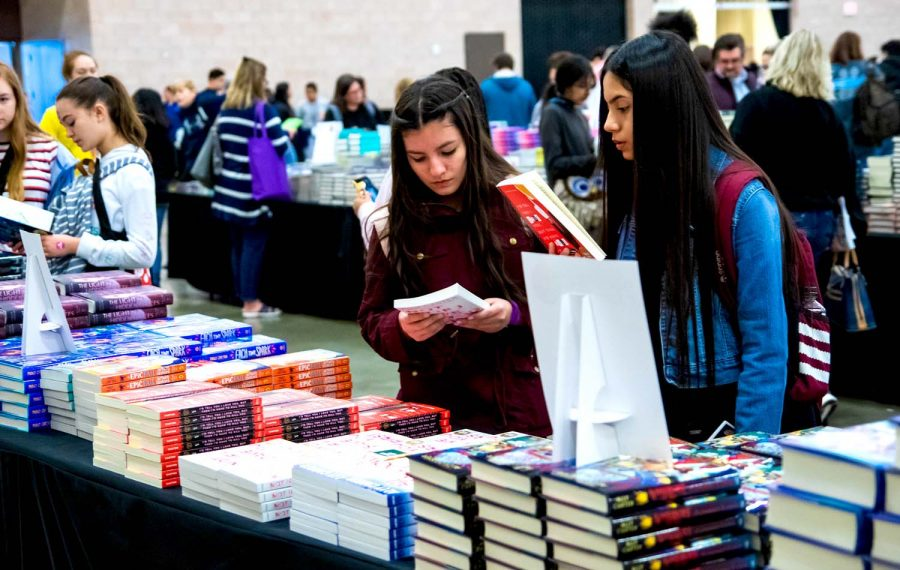 Teens browse through signed copies of books at  the North Texas Teen Book Festival in Irving, Texas.
