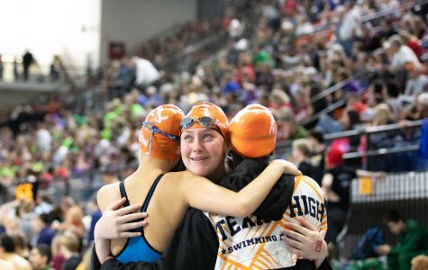 Senior Kaitlyn Rogers hugs her relay teammates as she finishes her last race as a Texas High Tigershark. The state meet was held February 15-16 in Austin, TX.