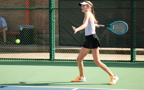 Freshman Lydia Lee plays tennis on the Texas High tennis court. Lee has played since she was three years old.