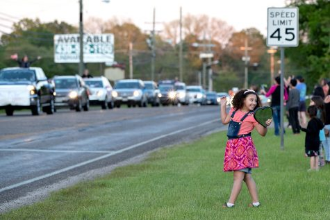 Nash Elementary third grade student Hannah Hamel smiles at her family as the teacher parade starts to pass Hannah's location on April 15, 2020. Nash Elementary teachers coordinated with the city of Nash to produce the teacher parade so that teachers could reconnect with their students during the COVID-19 pandemic.