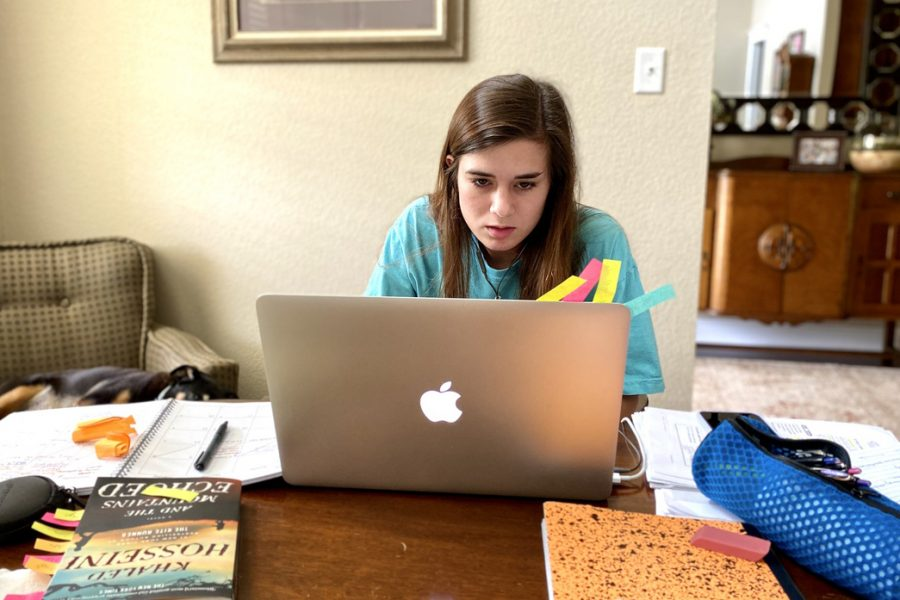 Senior Clara Smith sits at her dining room table working on her assignments. Texas High School transitioned to online education following the spread of COVID-19.