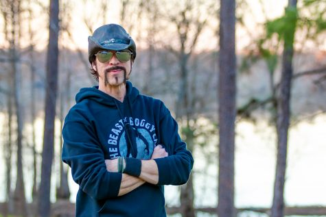 "Lyle Blackburn poses in his ""Beast of Boggy Creek"" hoodie. Blackburn has written two books about the Fouke Monster as well as other legends across the country."