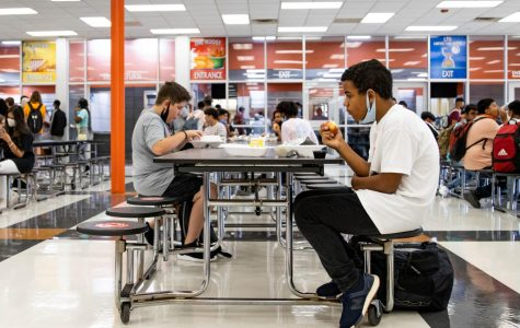 A student eats his lunch while socially distancing at the table. Texas High decided to add an additional fourth lunch to decrease the amount of people in the cafeteria at once.