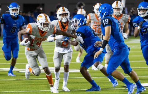 Wide receiver Tre Roberts protects the ball from the Tyler High School Lions on the run after a catch. Texas High School defeated Tyler High School 41-21 Thursday, September 24th, at Rose Stadium.