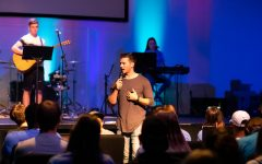 Church on the Rock's youth pastor leads during worship. Churches gathered together on Oct. 21 for Fields of Faith via livestream.
