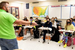 History teacher Danny Williams leads his class in discussion. Every student on campus is required to be masked.