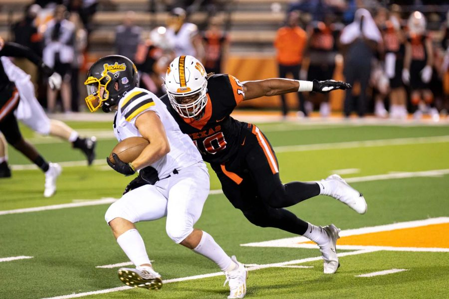 Texas High's Clayton Smith pursues Denison's Asa Osborn in the second quarter of the home opener on Oct. 2, 2020. The Tigers defeated the Yellow Jackets 24-3 improving their record to 2-0.