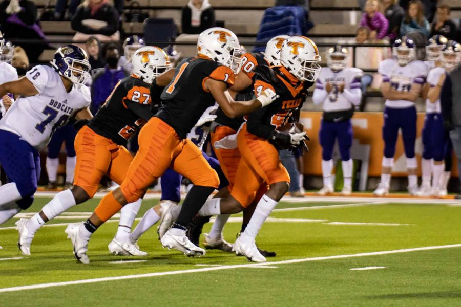 Derrick Brown returns an interception towards the goal line with his teammates helping blocking. The tigers defeated Hallsville with a score of 56-17.