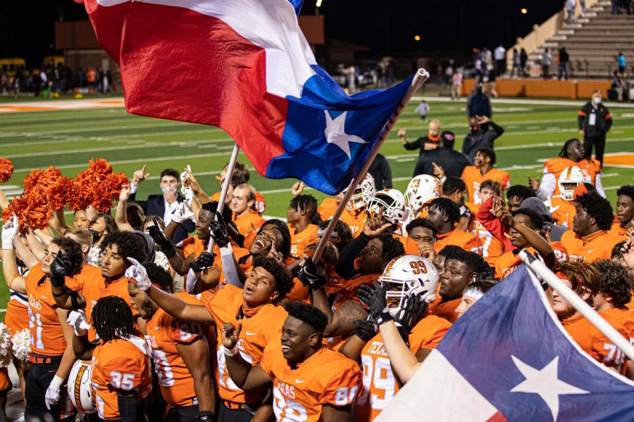 The Texas High Tigers celebrate a victory by singing the school song together. The Texas Tigers won against the Forney Jackrabbits on October ninth of twenty-twenty .