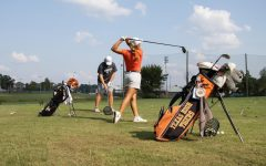 Senior Graci Henard practices her drives during practice. Henard has faced the trials of applying to college during a pandemic.