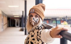 Senior Tatum Haugh poses in her leopard Halloween costume. Having to wear face masks hasn't stopped people from creativity dressing up.