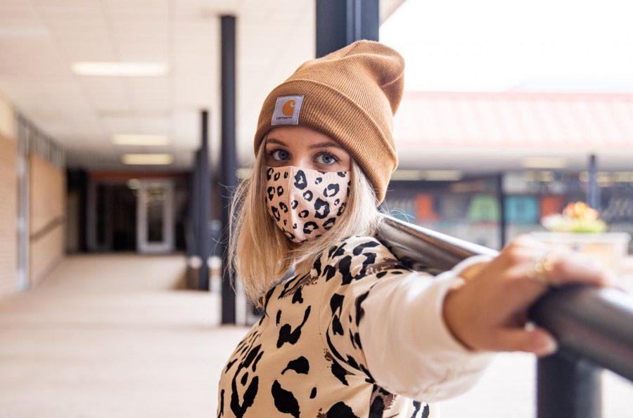 Senior Tatum Haugh poses in her leopard Halloween costume. Having to wear face masks hasn
