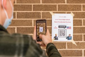 A Texas High student participates in the mock election. Flyers were posted around campus Oct. 29.