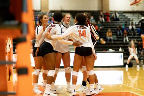 The Lady Tigers come together in celebration after a point earned against Tyler High School. The Tigers continued their path of an undefeated season following their game against Tyler.