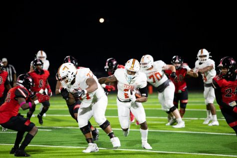 Junior Braylon Stewart breaks through the Marshall defensive line. Stewart led the team to a 28-0 win providing three touchdowns and 254 yards rushing.
