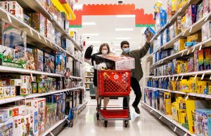 Two Black Friday shoppers rampage through an aisle at Target. This year, if the customers are not shopping from home, they're expected to wear masks upon entry.