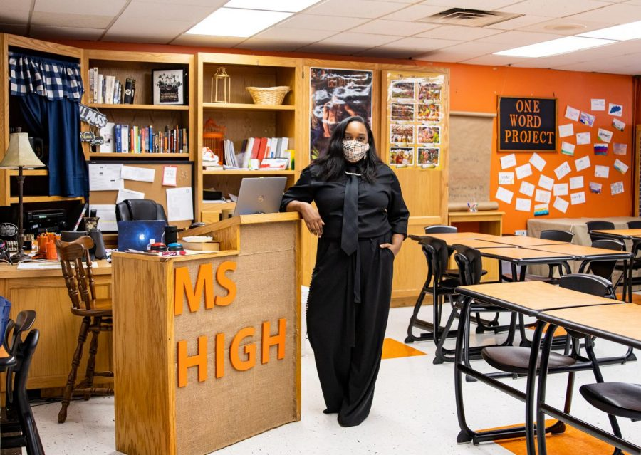 English teacher Jordan High poses in her new classroom. High began her teaching career this August alongside being a Radio DJ, dance teacher, an author and a mother.