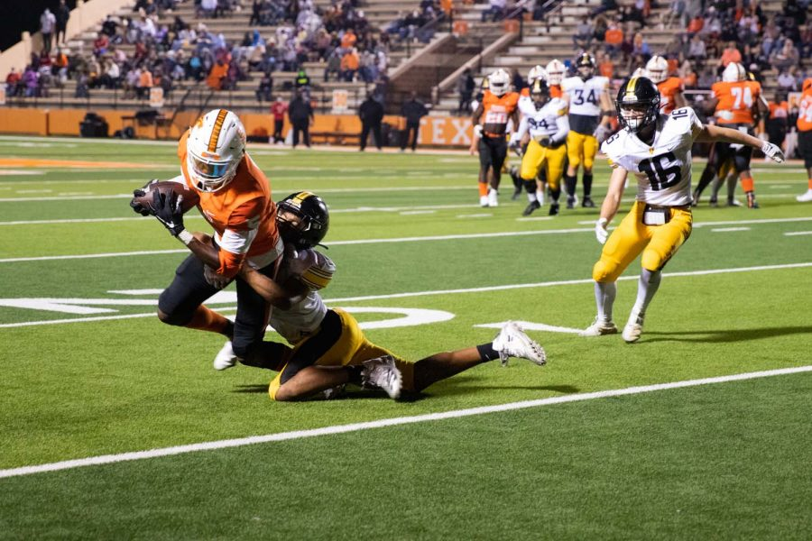 Rian Cellers withstands a tackle from Forney High defense. Cellers scored three recieving touchdowns at the homecoming game on Oct. 9.