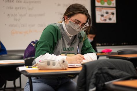 Junior Beth Dietze takes notes during an in-class lecture. Being diagnosed with dyslexia ever since she was young, Dietze is faced with challenges on a daily basis.