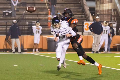 Junior Derrick Brown causes a fumble in the first quarter in the game against Lake Creek in the first round of the 2020 playoff season. The Tigers did not capitalize on the fumble recovery.