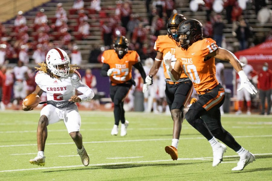 Crosby runningback Reggie Branch attempts to evade Texas High's Clayton Smith and Derrick Brown last Friday night during the second round of the 2020 playoffs. The Tigers battled the Cougars at Lumberjack Stadium on the campus of Stephen F. Austin University in Nacogodches, Texas.
