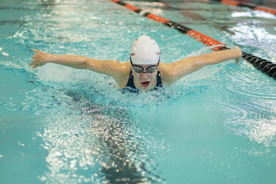 Sophomore Teagan Jones spreads her arms in the butterfly event while racing swimmers from El Dorado and Magnolia on Saturday Dec. 4, 2020. The Tigersharks hosted only two teams because of COVID-19 social distancing rules imposed by the University Interscholastic League.