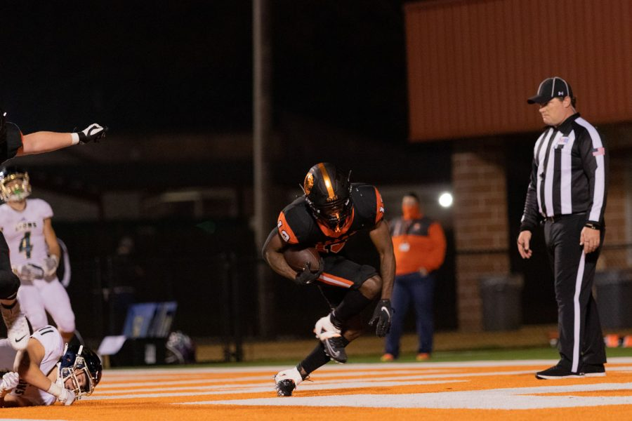 Senior Daquarreon Collier-Witcher stuts in the end zone. Witcher played as the starting running back.
