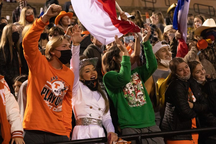 The student section at Grim Stadium celebrates in victory as the Texas Tigers win the game against the Lions.