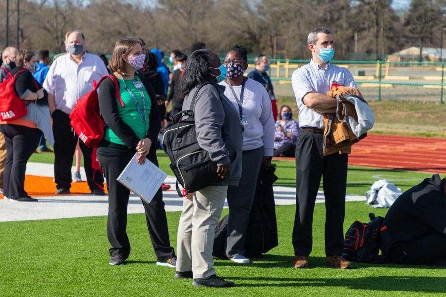 Teachers group together during the emergency many unaware of the threat sent to the school. The Texas High School staff was on standby, waiting for an all-clear from police and fire departments.