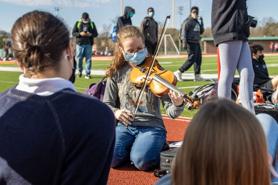 Teagan Jones plays the violin for other students awaiting further instruction from teachers. Students found ways to entertain themselves in the time they had out of classes.