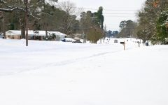 Snow covers Old Redwater Rd. in Wake Village on Feb. 15. The winter storm forced multiple roadways to shutdown.