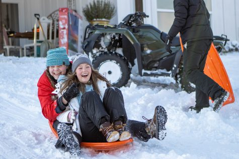 Seniors Malley Wallace and Endsley Norman sled down a snowy hill on Feb. 15. While the cold weather has proved to be fun, some people struggle with knowing how to properly tackle the snow.