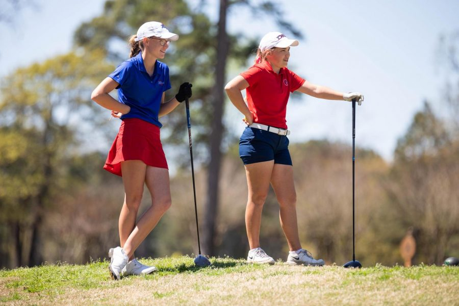 Senior Graci Henard stands with her partner during the ASGA Junior Four-Ball Championship. Henard and her partner won the tournament for the girls, and her teammates Carter Maneth and Camden Robertson won for the boys.