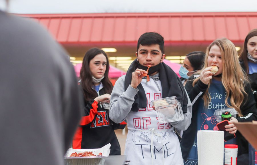 Students eat the pre-prepared meals during the annual Bacon Fry. The individually packadged bisquits and bacon were set out for seniors to grab before school.