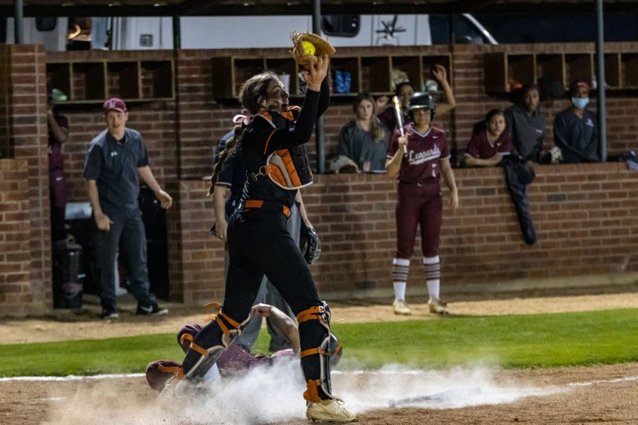 Sophomore Emma Prince catches the ball at home in an attempt to get Liberty Eylau player out. The Lady Tigers beat rival school, Liberty Eylau 9-7.