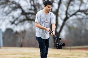 Senior Assad Malik shoots a clip for a news package video. Malik has won numerous awards for his videography work.