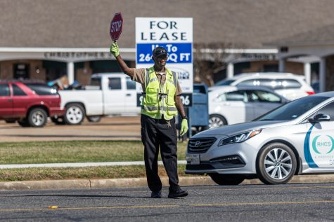 A TISD guard directs after school school traffic. The TISD traffic guards work shifts before and after school.