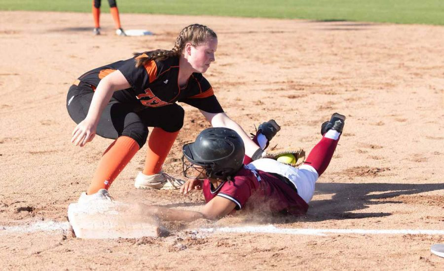 Senior Mollie Johnson gets a player from the opposing team out as she slides to first base. Johnson is the only senior returning to the Lady Tiger's softball team.