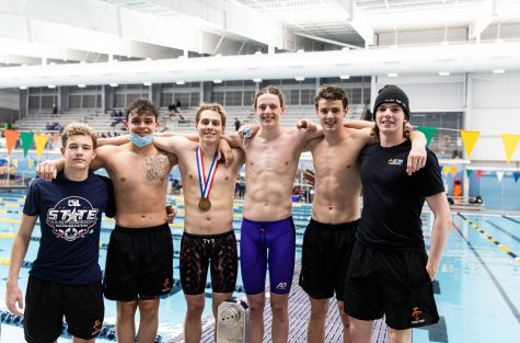 Owen Young, Logan Diggs, John David Cass, Eli Likins, Evan Likins and Nathan Morris pose for a picture at the 2021 UIL state swim meet. Swimmers traveled to San Antonio to compete against swimmers from all over Texas.