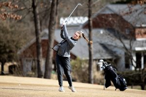 Junior Angie Parrott hits the ball during the Pleasant Grove Invitational at Northridge Country Club Feb. 25. Parrott shot a personal best of 87.
